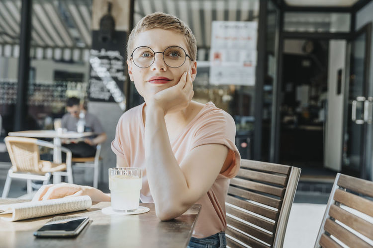 Portrait of young woman in restaurant