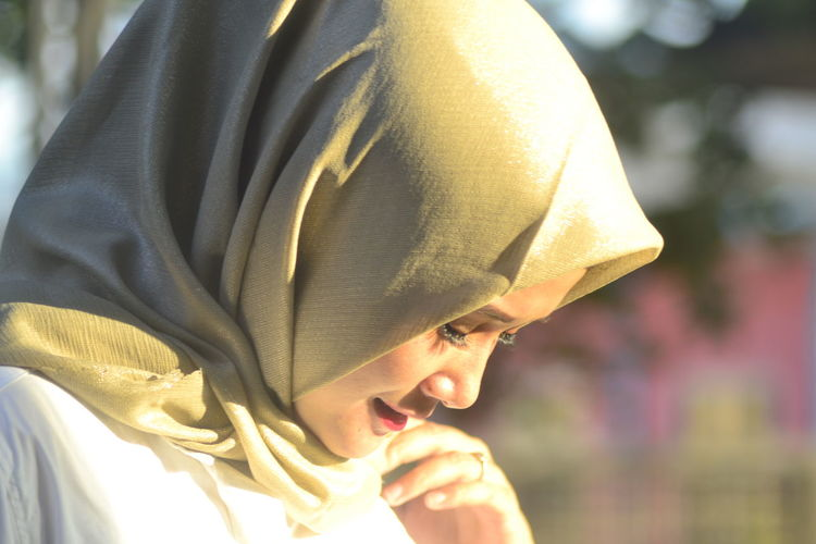Close-up portrait of young woman outdoors