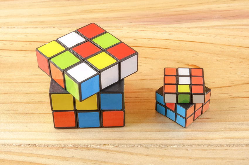 RUBIK'S CUBE , CREATIVITY TOY Creativity Rubik Cube Childhood Choice Close-up Creativity Cube Shape Design Directly Above Geometric Shape Indoors  Intelligence Large Group Of Objects Multi Colored Puzzle  Rubik Shape Still Life Table Toy Toy Block Variation Wood - Material