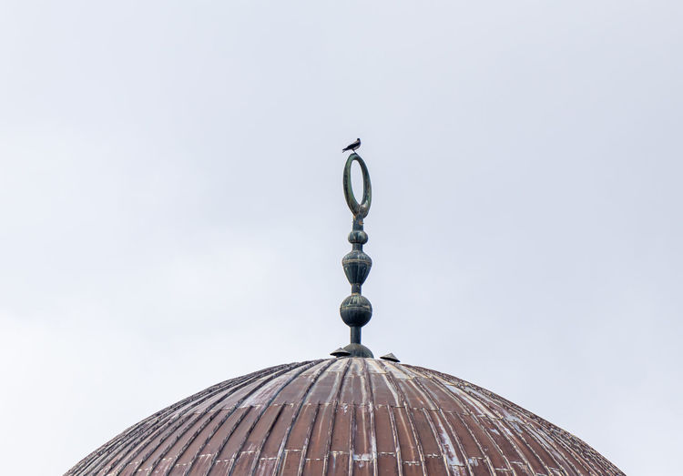 Low angle view of dome of mosque against clear sky