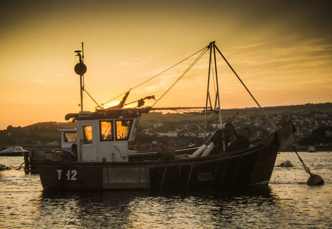 Teignmouth Harbour Sunset Beach Boat Calm Devon E.U. Fishing Fish Fishing Harbour Mode Of Transport Nautical Vessel Orange Color Reflection Rippled Sea Sky Sunset Teignmouth Tourism Transportation Travel Destinations View Of Harbour Vivid International Water Waterfront Yellow