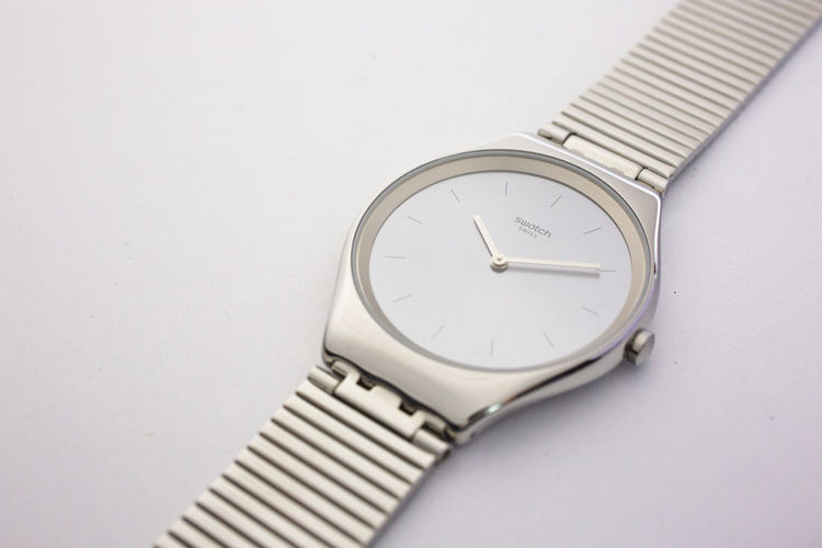 Close-up of wristwatch over white background