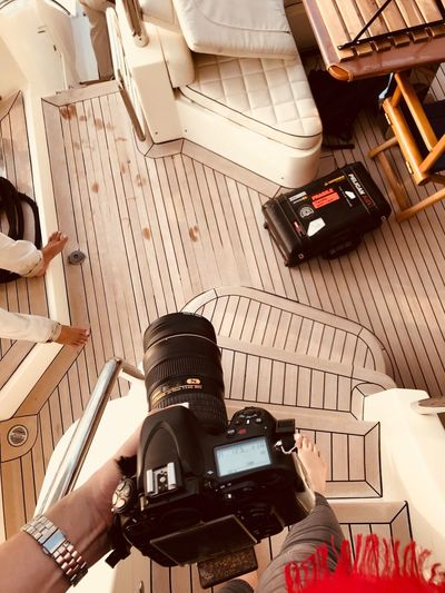Arabian Moment Real People One Person High Angle View Technology Indoors  Day Transportation Lifestyles Camera - Photographic Equipment Sitting Leisure Activity Photography Themes Men Built Structure Architecture Mode Of Transportation Creativity Activity