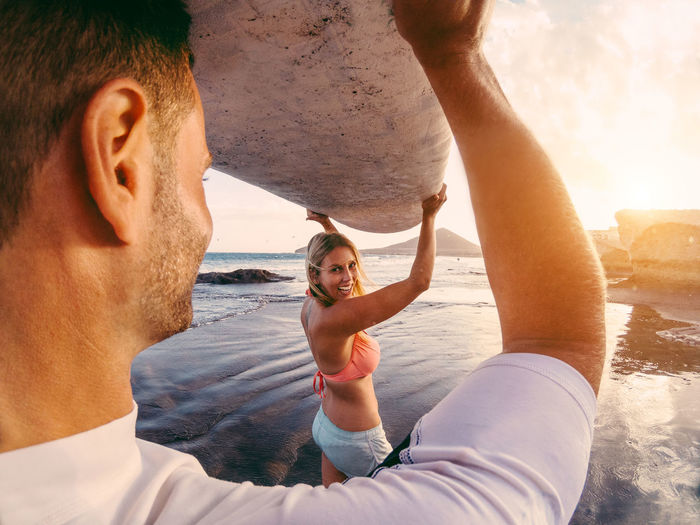 A surfer couple on the beach Couple Man Surf Surfer Travel Woman Young Activity Balance Beach Extreme Sports Happiness Lifestyles Love Nature Outdoors People Sand Sea Smiling Sport Surfboard Togetherness Vacations Water