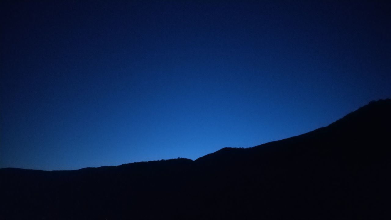 silhouette, copy space, blue, clear sky, tranquility, nature, tranquil scene, no people, beauty in nature, mountain, outdoors, scenics, landscape, day, sky