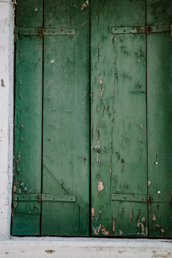 Textured peeling wooden background Architecture Backgrounds Building Building Exterior Built Structure Closed Day Door Entrance Full Frame Green Color No People Old Outdoors Protection Safety Security Wall - Building Feature Weathered Wood - Material