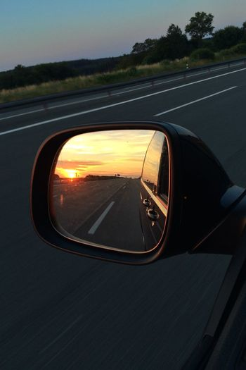 Sunset in rear view.
