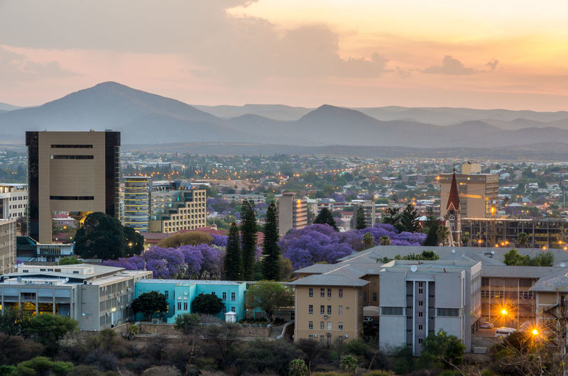 Skyline of Windhoek City at Sunset African Namibia NamibiaPhotography Residential  Skyline Architecture Building Capital Cities  Cities City City At Dusk City At Sunset Cityscape Cloud - Sky High Angle View Illuminated Mountain Mountain Range Residential District Skylines Skyscraper Sunset Travel Destination Urban Windhuk
