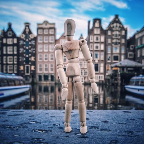 Amsterdam houses and me Figurine  Travel Destinations Amsterdam Amsterdam Canal Woodyforest Architecture Building Exterior Human Representation Built Structure Male Likeness City Art And Craft Close-up Day Sky City Life