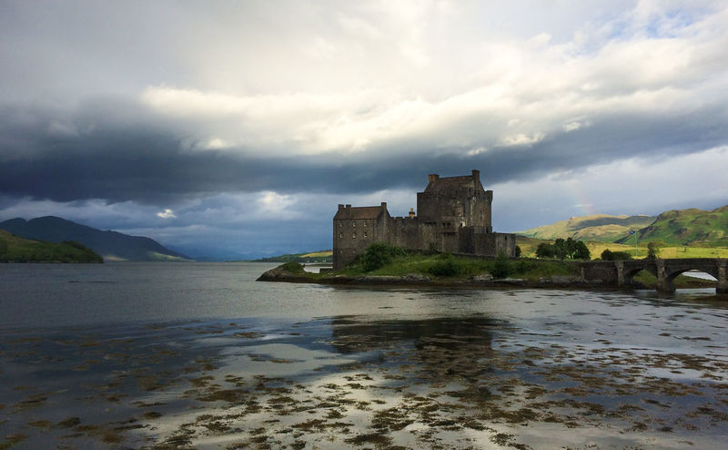 Eilean Donan Castle Architecture Building Exterior Built Structure Castle Castle Changing Weather Cloud - Sky Cloudy Eilean Donan Eilean Donan Castle History No People Old Rainbow Scenics Scotland Scotlandsbeauty Sea Loch The Past Water Weather Weathered