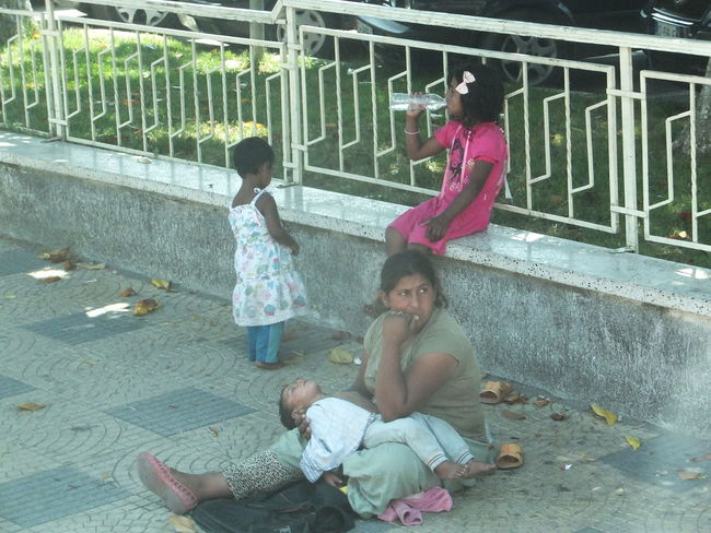 Begging in Shkoder Street Albania Begging Children Composition Full Frame Lifestyle No Incidental People Outdoor Photography Poor People  Railings Sad Face Shkoder Street Streetphotography Woman