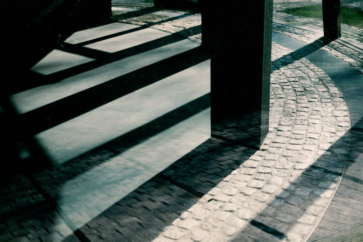LIGHTS | SHADOWS | REFLECTIONS Shadow Day Footpath Sunlight Architecture No People High Angle View Pattern Outdoors Nature Built Structure City Street Staircase Transportation Close-up Railing Metal Sidewalk Stone Paving Stone Focus On Shadow
