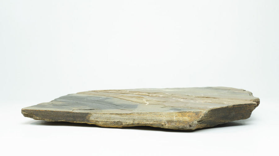 Close-up of rock against white background