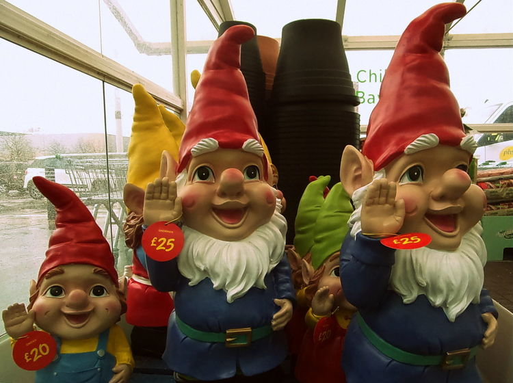 attack of the Gnomes Casual Clothing Childhood Composition Cultures Cute Front View Fun Happiness Holding Innocence Leisure Activity Lifestyles Person Perspective Portrait Real People Sitting Three Quarter Length Waist Up Young Adult