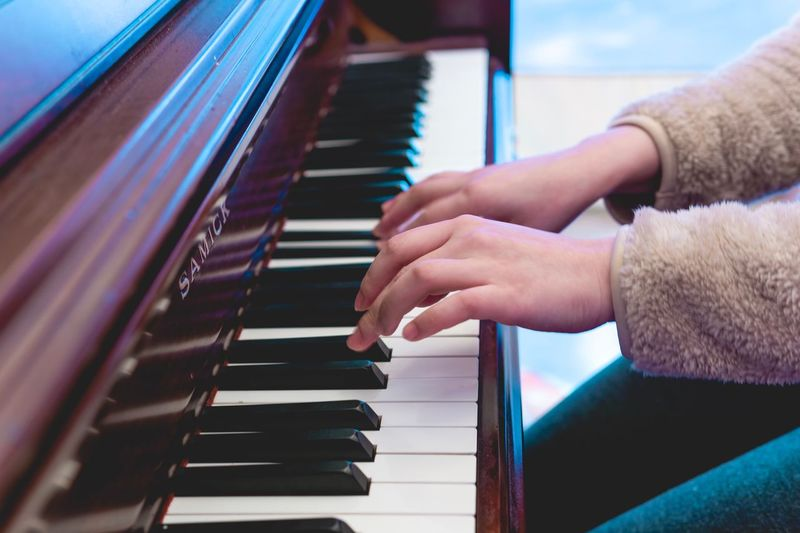 Musical Equipment Piano Musical Instrument Human Hand Music Hand Piano Key Real People One Person Lifestyles Playing Finger Human Finger Keyboard