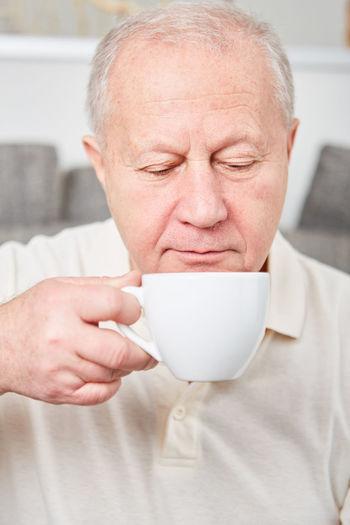 Close-up portrait of a man holding ice cream