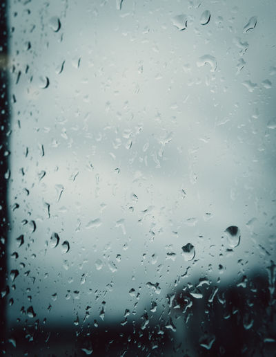 Wet Glass - Material Drop Window Water Rain Transparent Full Frame Backgrounds Indoors  No People Sky RainDrop Nature Close-up Rainy Season Glass Day Purity