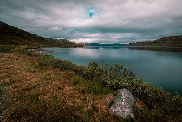 Tranquility Water Cloud - Sky Beauty In Nature Sky Scenics - Nature Mountain Tranquil Scene Tranquility Lake Nature No People Environment Day Landscape Non-urban Scene Plant Outdoors Mountain Range Reflection Norway Fjordsofnorway Relaxing Silence Of Nature Cloudy Beauty In Nature