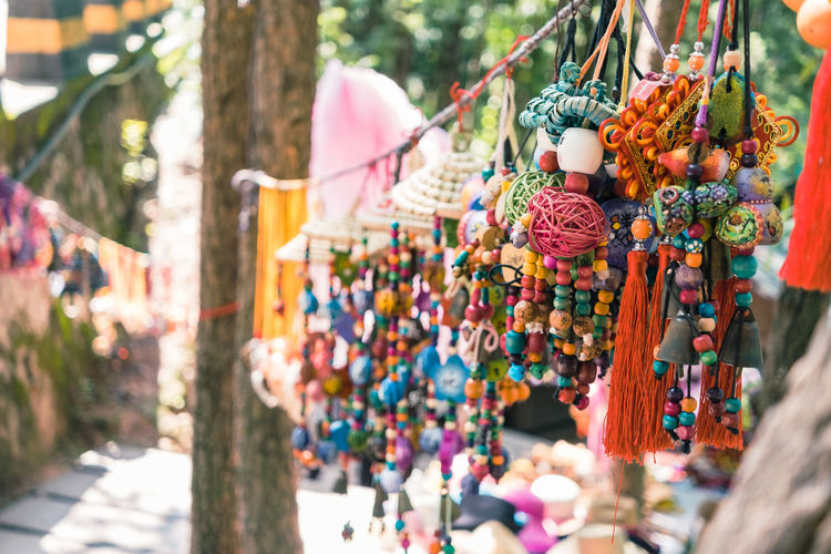 Colorful bead necklaces hanging at market for sale