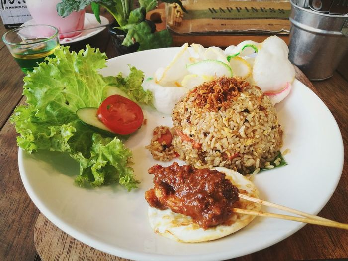 Fride Rice with Sate and Sunny side up Homemade Plate Healthy Lifestyle Table Egg Yolk Vegetable Close-up Food And Drink Serving Dish Fried Rice Fried Egg Sunny Side Up Fried