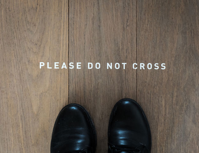 See on the floor of the Modern Art Museum (Mudam) in Luxembourg Mudam Black Color Black Shoes Close-up Communication Day Feet Floor Floorboards High Angle View Indoors  Low Section Message One Person People Shoe Standing Text Timber White Wood - Material