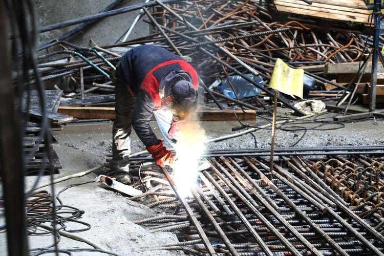 High angle view of man working on metal