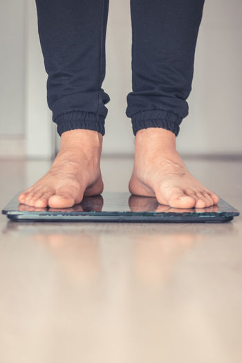 Copy Space Measuring Weight Scale Bathroom Scale Body Care Caucasian Dieting Floor Healthy Lifestyle Human Foot Human Leg Indoors  Lifestyles Low Section Men One Person People Standing Weight Weight Control Weightloss