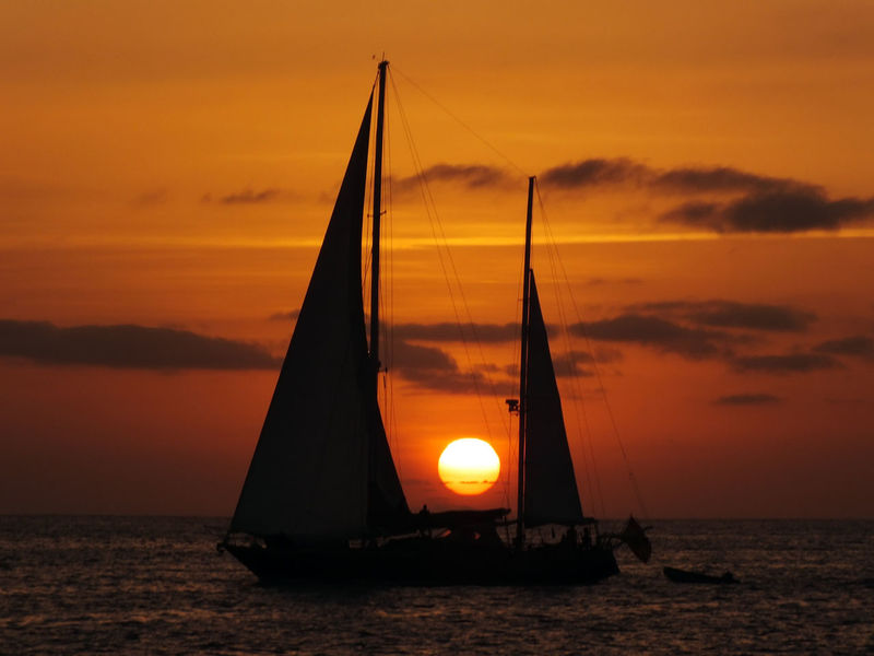 Atmosphere Boat Dramatic Sky Horizon Over Water Idyllic Majestic Moment Nature Nautical Vessel Orange Color Perfect Match Sailboat Sea Silhouette Sky Sun Sunset Tranquil Scene Tranquility Transportation Water Waterfront The Color Of Sport Sommergefühle