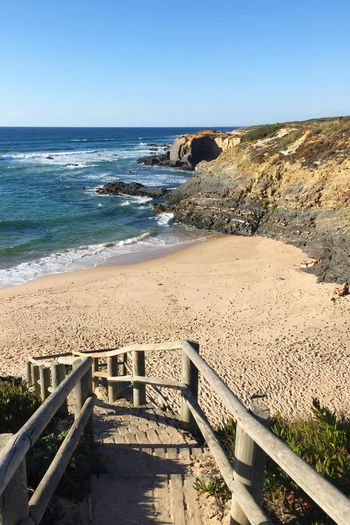 Almograve Alentejo Costa Vicentina Portugal Beach Beachphotography Beauty In Nature Stairway Stairs Sea Water Sand Shore Horizon Over Water Tranquil Scene Clear Sky Tranquility Scenics Blue Nature Non-urban Scene Vacations Tourism Travel Destinations Railing Wave Summer