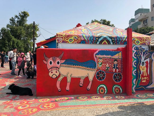 RAINBOW VILLAGE Streetart Wall Art Mural Graffiti Animal Rainbow Village Painting Traveling Travel Taichung Taiwan Folklore Art Dog Buffalo Red Art And Craft Multi Colored Day Outdoors Built Structure Real People Large Group Of People Architecture