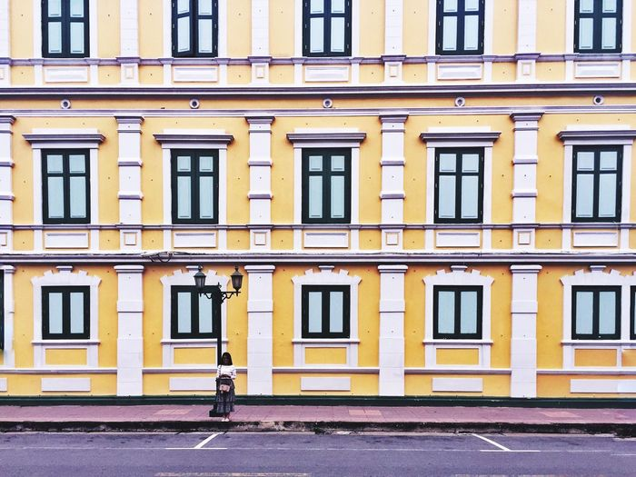 Architecture Building Exterior Yellow Built Structure Window Street Outdoors One Person