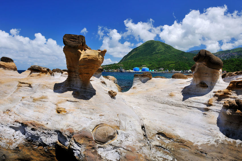 Taiwan's Northeast Coast Scenic Area, beautiful scenery, pleasant scenery, coastal landscape, natural beauty, coastal rock changes Beautiful Cool Natural Rock Formation Sunny Beauty In Nature Cloud - Sky Clouds And Sky Coastal Day Mountain Nature New Taipei City No People Outdoors Rock - Object Scenics Sky Tranquility Water