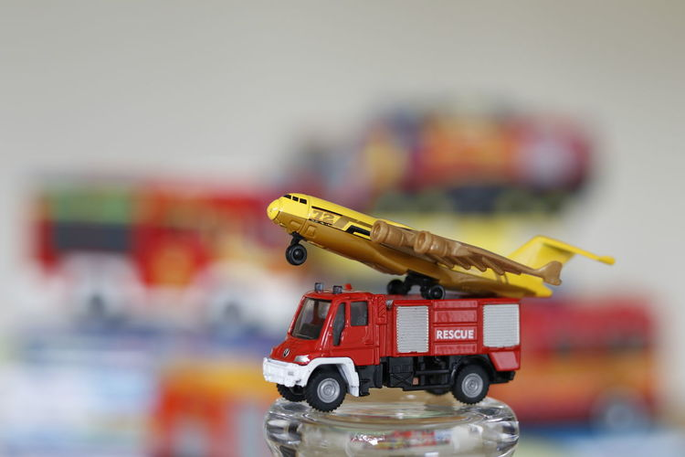 Close-up of toy car and plane on table