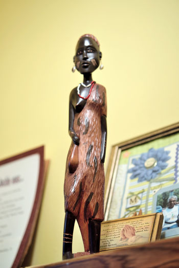 Mom's Figurines 2 African Art African Female Still Life Photography Still Life Collectibles Figurine  Wooden Statuettes Hand Carved Traditional Dress Symbols Of Human Culture For Arts Sake Abstract Photography Abstract Low Angle View Framed Collage Mom Pictured (rgt-hand Corner)
