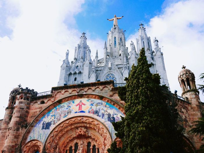 Low angle view of temple expiatori del sagrat cor against sky