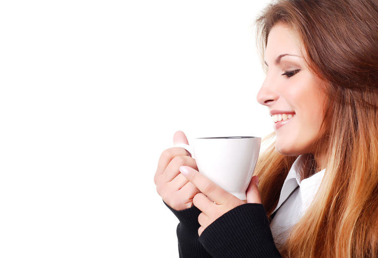 Portrait of beautiful young woman with cup of coffee Young Adult One Person Smiling Young Women Women Headshot Cup Happiness Copy Space White Background Drink Mug Holding Coffee - Drink Lifestyles Indoors  Beauty Portrait Beautiful Woman Drinking Hair Hairstyle Hot Drink