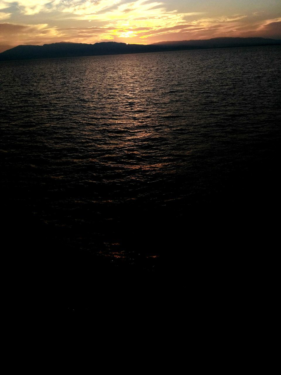 sunset, scenics, tranquil scene, beauty in nature, water, nature, tranquility, reflection, sky, silhouette, idyllic, rippled, no people, waterfront, lake, outdoors, cloud - sky, day