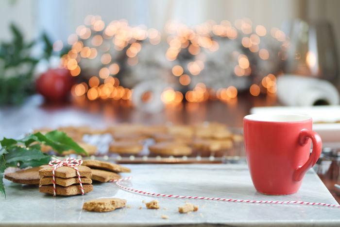 Baking Cookies Christmas Cookies Christmas Spirit Gingerbread Man Holiday Season Presents Celebrating Christmas Season Close-up Coffee Break Day Gifts Gingerbread Gingerbreadman Holiday Cookies Indoors  Preparation  Preparations Starshape Table
