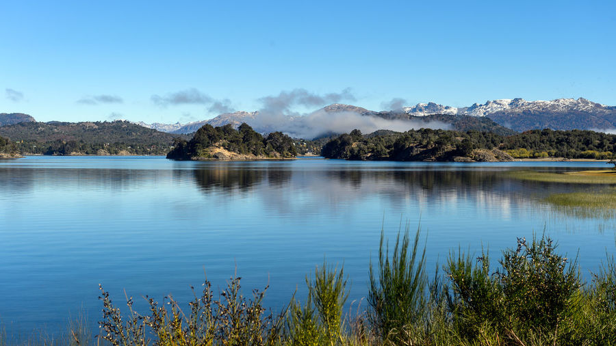 Villa Pehuenia - Neuquén - Argentina Beauty In Nature Blue Day Lake Landscape Mountain Nature No People Outdoors Scenics Sky Tranquil Scene Tranquility Tree Water