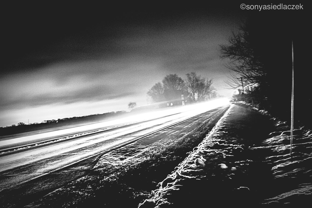 motion, weather, outdoors, long exposure, no people, sky, nature, winter, cold temperature, water, tree, transportation, scenics, road, day, beauty in nature, snow