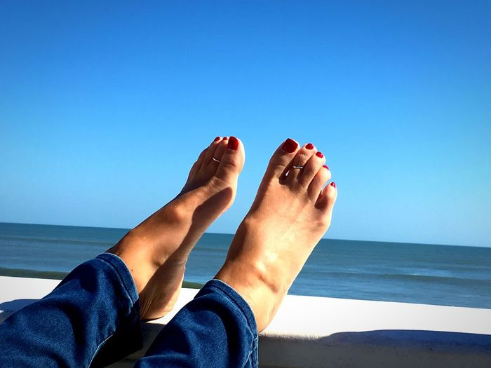 EyeEm Selects Barefoot Human Foot Sea Human Leg Low Section Human Body Part Blue Beach Water Horizon Over Water Clear Sky Personal Perspective Day Sunlight One Person Leisure Activity Relaxation Outdoors Vacations Women