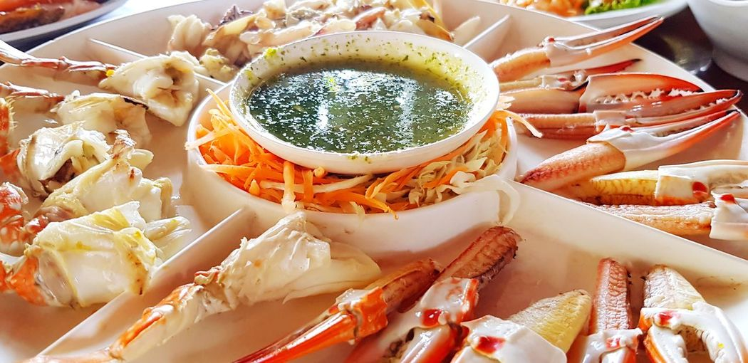 Many fresh crab leg on plate Food Food And Drink Freshness Healthy Eating Wellbeing Close-up Ready-to-eat Still Life Seafood Plate Serving Size Indulgence High Angle View Meat Preparation  Appetizer Snack Temptation Leg Seafood Animal Sauce Spicy Crab Delicious