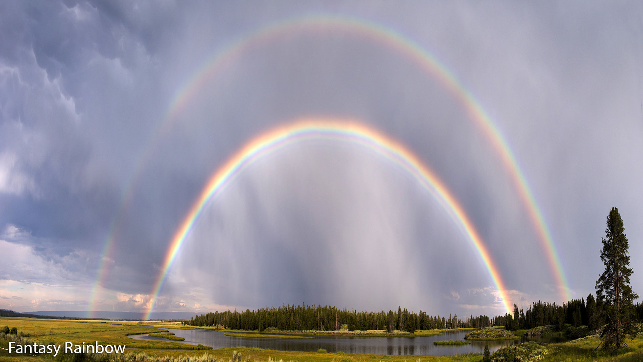 rainbow, multi colored, sky, scenics, beauty in nature, cloud - sky, tranquil scene, tranquility, nature, tree, landscape, idyllic, cloudy, grass, weather, field, outdoors, cloud, colorful, panoramic
