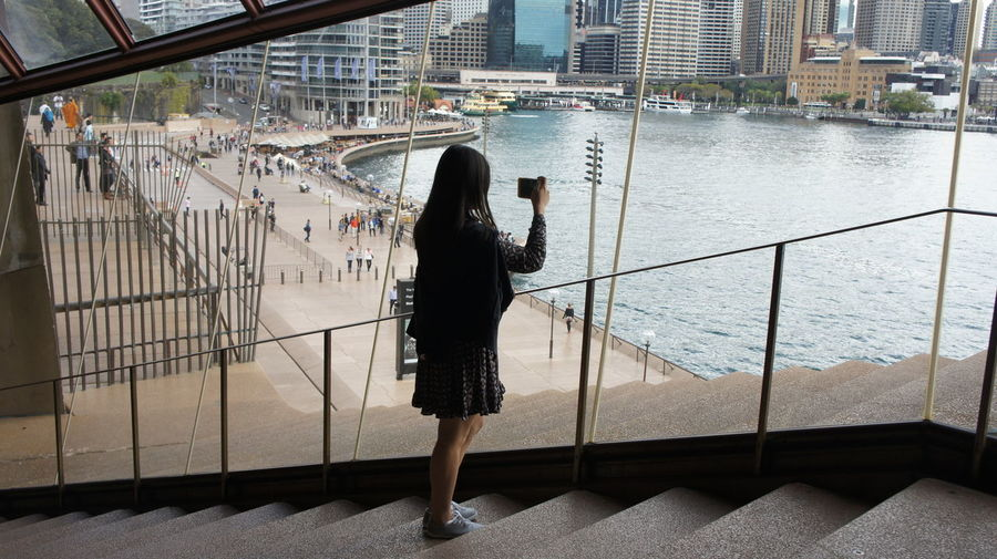 Woman Taking Picture Of Waterfront