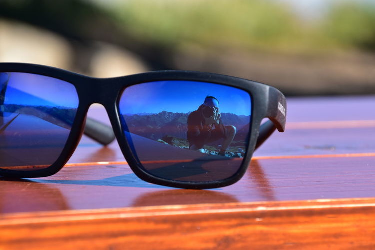 Reflection of sunglasses on side-view mirror