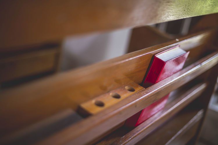 CHRIST CHURCH! Christ Church College Arrangement Arts Culture And Entertainment Bible Brown Christ Church Close-up Container In A Row Indoors  Large Group Of Objects Music Musical Equipment Musical Instrument No People Order Red Selective Focus Still Life String Instrument Table Wood - Material