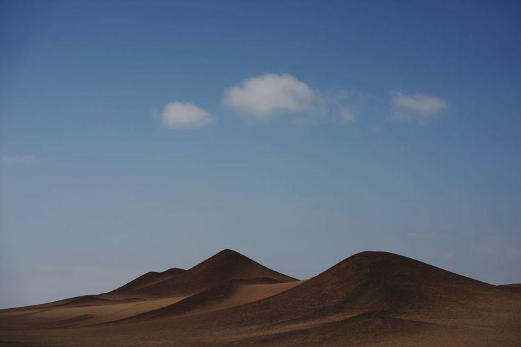 Scenic view of desert against sky in paracas peru