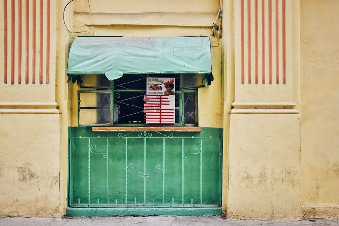 Hello, one coffee please. Architecture Built Structure Door Shop Coffee Cuba Building Exterior Coffee Shop Streetphotography Street Yellow Yellow House  South America Havana Cuban Streets Urbanity City City Life Paint The Town Yellow Been There.
