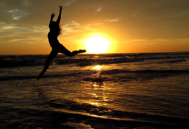 Sunset in Punta del Este, Uruguay Beach Life Beach Photography Dance Jump Summertime Sunset_collection Beach Beachphotography Beauty In Nature Fun Horizon Over Water Jumping Jumpshot Lifestyles Nature Orange Color Real People Sea Silhouette Sky Summer Sunset Uruguay Uruguaynatural Women