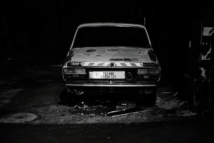 Abandoned car at night